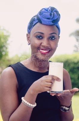 Young Woman Holding a Glass of Yoghurt